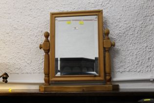 Pine dressing table mirror, 52 cm wide and 49 cm high.