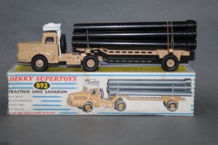 A Dinky Tracteur Unic Saharien (893), with pipe carrier and semi trailer,