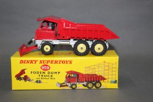 A Dinky Foden dump truck with bulldozer blade (959), in red,