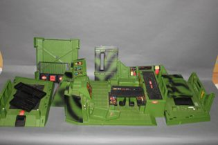 A disassembled and incomplete 1980's Action Force headquarters,