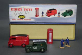 A Dinky gift set, Post Office Services (299), containing a red Royal Mail van (260),