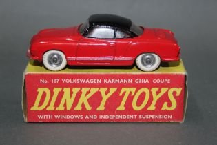 A Dinky Volkswagen Karmann Ghia coupe (187), having red body, black roof, spun hubs and white tyres,