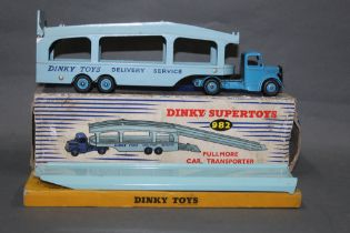 A Dinky Pullmore car transporter (982), and a loading ramp (794),