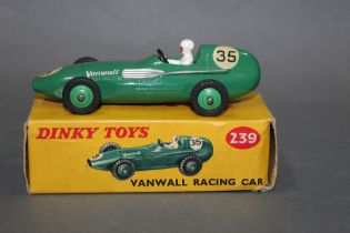 """A Dinky Vanwall racing car (239), having a green body, green hubs, a white driver, a """"35"""" decal,"""