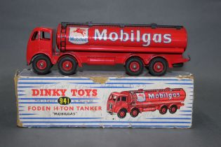 """A Dinky Foden 14-ton """"Mobilgas"""" tanker (941), in red,"""