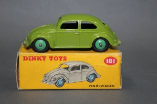 A Dinky Volkswagen Beetle (181), having a lime green body and mid green hubs,