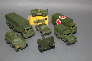A group of six Dinky and one Britain's army vehicles and accessory,