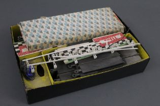 A boxed part Scalextric set, comprising hand throttles, track,
