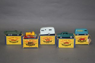 A group of five Matchbox Series diecast model vehicles,