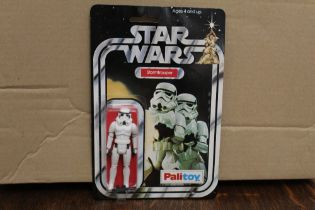 A Palitoy Star Wars Storm Trooper 3 3/4in action figure, with laser rifle,