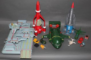 A group of Carlton plastic Thunderbirds toys, to include Thunderbird '1', '2', and '3',