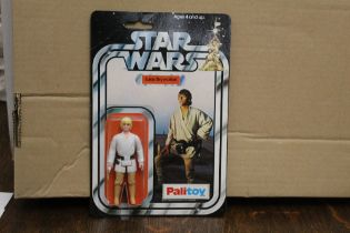 A Palitoy Star Wars Luke Skywalker 3 3/4 ins action figure, with action light sabre,