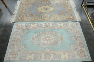 Two patterned rectangular rugs one fringed