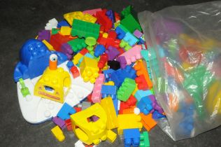 Bag of large childrens building blocks in the style of large Lego