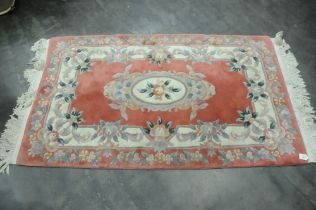 Patterned rectangular fringed rug