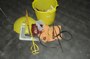 A yellow bin of hand tools