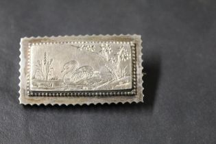 A Victorian white metal rectangular brooch engraved with a swan