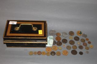 An early 20th century painted metal cash tin,
