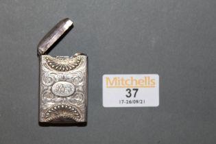 A Victorian silver vesta case, engraved with leaf scrolls, 4.