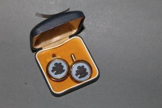 A pair of Wedgwood gold plated and jasper ware cufflinks, with circular faces,