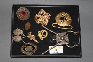An RAF sweethearts brooch with by-plane pendant (lacking pin) and badge, military button,