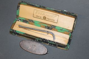 A 19th century white metal oval brooch engraved with a steam engine, possible Stephenson's Rocket,