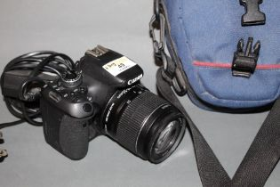 A Canon EOS 600 digital SLR camera with 18-55 mm lens and a Lowe Pro camera bag together with a