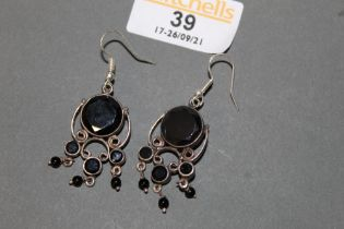 A pair of white metal and black onyx pendant earrings