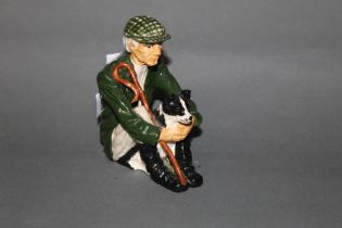 A Shebeg pottery figure of a seated shepherd and sheep dog 11.