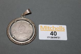 An eastern white metal coin, worded in Iranian,