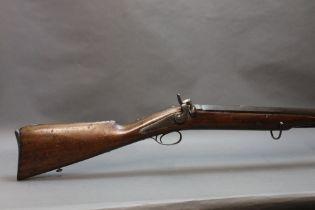 A percussion large calibre (possibly 4 bore) rifled gun,