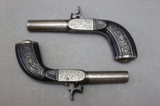 """* A pair of steel percussion pocket pistols, with 2 1/2"""" barrels and fold down triggers,"""