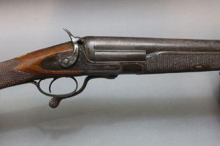 "An English single barrel 10 bore hammer shotgun, with a 34"" barrel, rotary underlever."