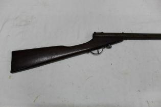* An unusual small caliber pump up air gun, circa 1910. Overall length 93 cm.