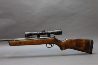 A BSA Super Sport cal, 22 break barrel air rifle, fitted with an SMK 4 x 32 telescopic sight.