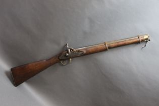A percussion cavalry carbine style gun, with brass trigger guard and butt plate,