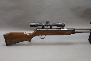 A Snowpeak cal 22 underlever air rifle, fitted with an ASI Superscope 4 x 40 telescopic sight.