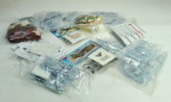A group of plastic model kits comprising various including Airfix MG1100. Appear to be complete