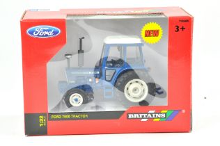 Britains 1/32 Farm issue comprising Ford 7600 Tractor. Note Wheel Conversion. Previously on display,