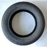 GAVIN TURK [b.1967]. Wheel Tyre, 2008. Used car tyre, signed and dated '08 in gold ink, from the