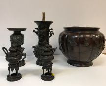A Japanese Meiji period chocolate patinated bronze vase of squash form decorated in high relief