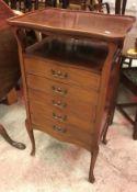 An Edwardian mahogany and inlaid music cabinet,