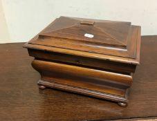 A Victorian walnut jewellery casket of sarcophagus bombé form,
