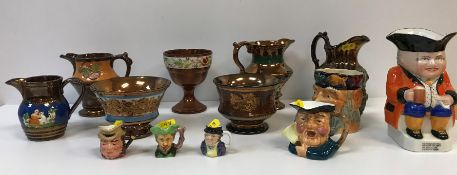 A collection of four Victorian copper lustre cream jugs, copper lustre goblet and two bowls,