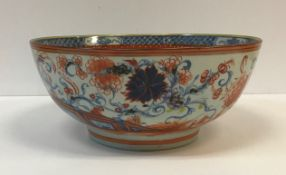 A Chinese polychrome decorated bowl set with flowers and insects, 29.