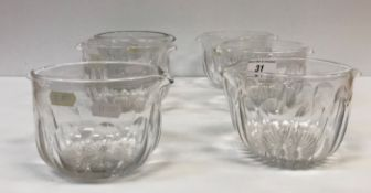 A collection of seven facet cut glass rinsers on star cut bases, 9 cm high x 12 cm diameter approx,