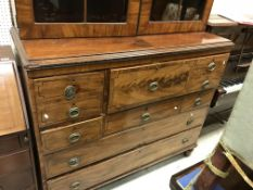 An early Victorian mahogany bookcase cabinet the astragal glazed doors enclosing four shelves,