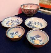A 19th Century Chinese Imari bowl decorated green and oxide red enamels with medallions of figures