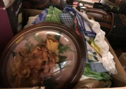 Two boxes of sundry items to include decorative china wares, assorted table linens, etc.