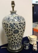 A modern blue and white baluster-shaped vase in the 19th Century Chinese taste,